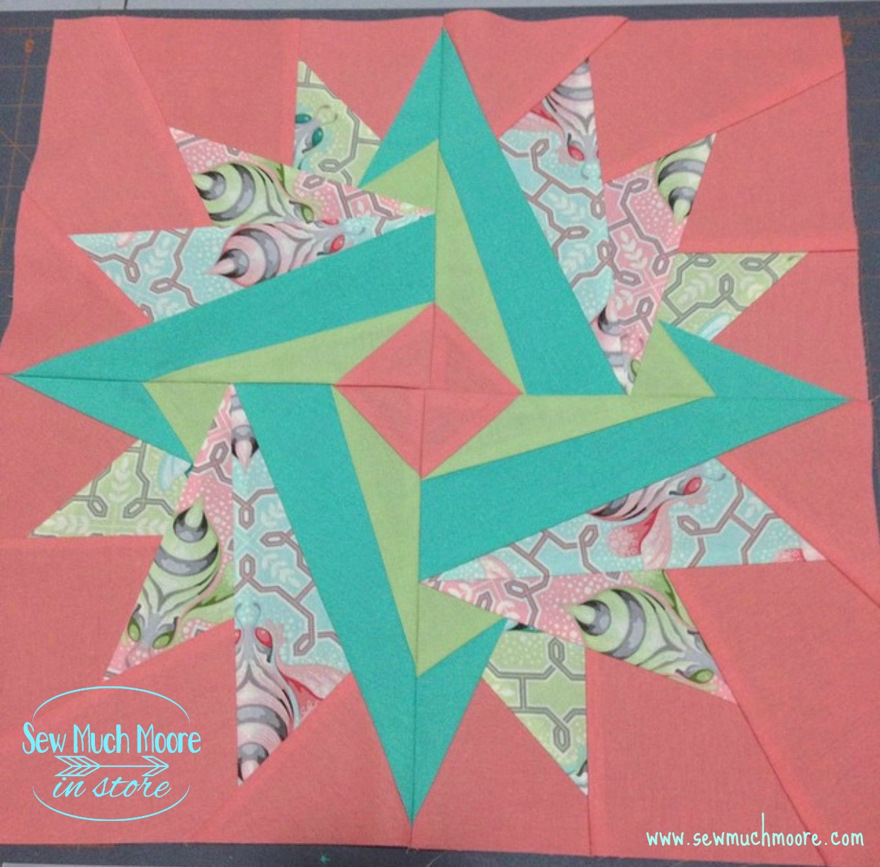 Make this lovely Springtime Mini Quilt! Get the pattern and materials list and get started! #Tutorial #Free #Pattern #Printables #Quilts #Pillows #Easy #Templates #Star #ForBeginners #Beginner #Art #Desgin #ArtDesign #Block #Hip #Trendy #SewMuchMoore #SewMuchMooreInStore