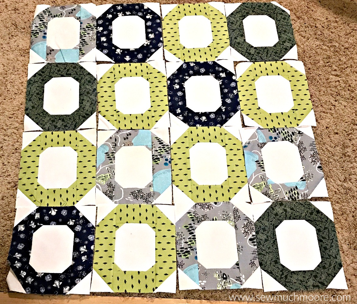 Deciding on a quilt layout is always fun. Learn how to make this cute baby quilt - It's fun and easy! #forbeginners #easy #jellyroll #ideas #modern #baby #ToMake #Designs #Simple #Blocks #Tutorial #HandQuilting #Big Stitches #Embroidery #quilting #sewing #handmade #GiftForBaby #FreeMotionQuilting #Project #Patchwork #Contemporary #WalkingFoot #DIY #Fabric #BabyBoy #BabyGirl #Nursery #Bedding #SewMuchMoore #SewMuchMooreInStore #Hip #Trendy