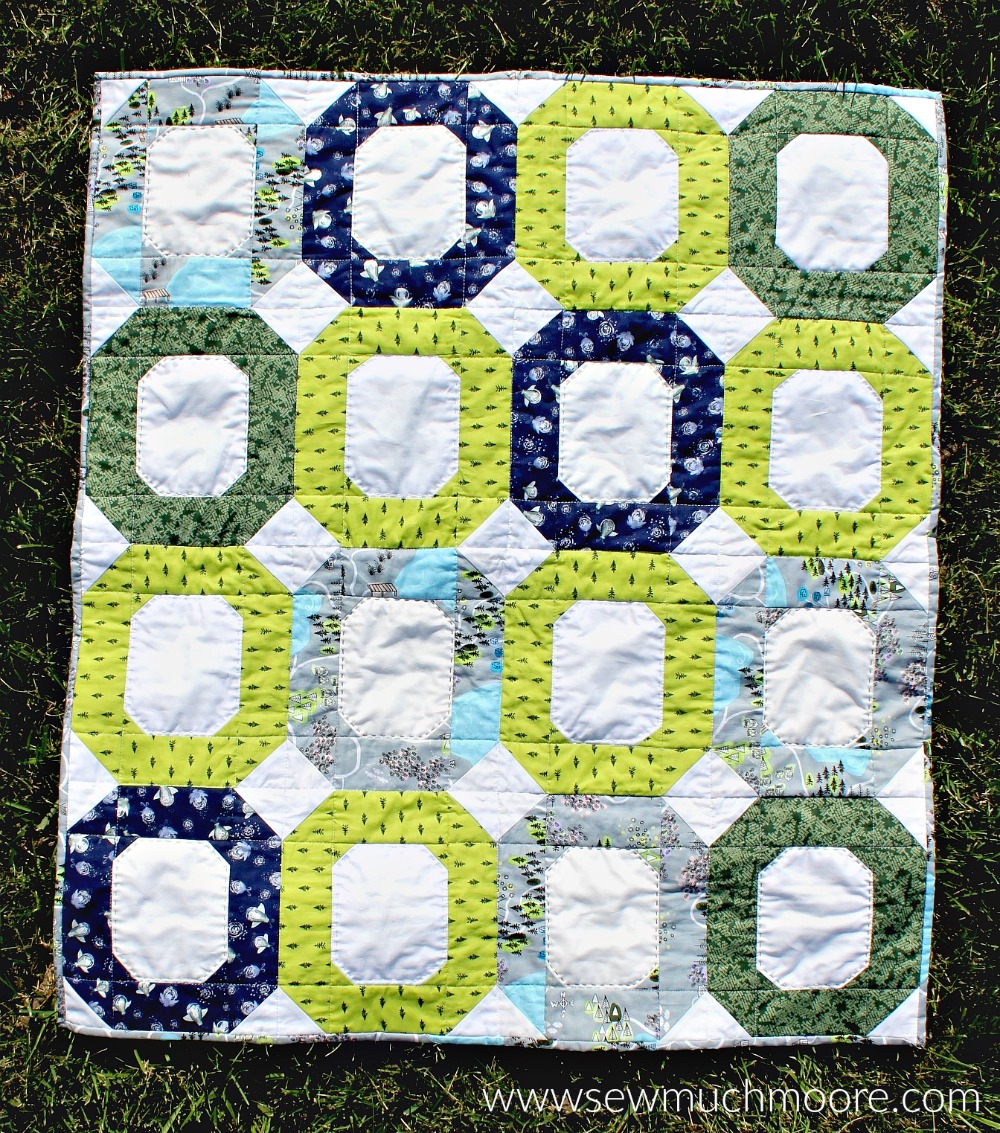 This baby quilt is super fun and easy to make! This modern quilt is perfect for a quick gift. #ForBeginners #easy #jellyroll #ideas #modern #baby #ToMake #Designs #Simple #Blocks #Tutorial #HandQuilting #Big Stitches #Embroidery #quilting #sewing #handmade #GiftForBaby #FreeMotionQuilting #Project #Patchwork #Contemporary #WalkingFoot #DIY #Fabric #BabyBoy #BabyGirl #Nursery #Bedding #SewMuchMoore #SewMuchMooreInStore #Hip #Trendy
