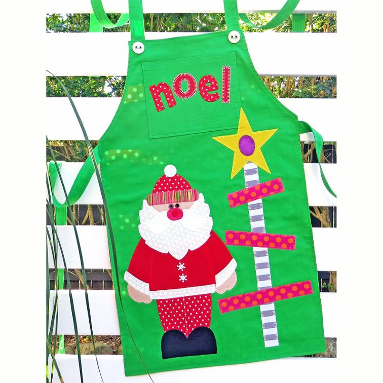 "Child's Christmas Apron - Check out this collection of fun and exciting patterns! Get started on your own Handmade Christmas! #Pattern #Printables #Quilts #Pillows #Easy #Templates #ForBeginners #Beginner #Art #Design #ArtDesign #Block #ChristmasQuilt #ForBeginners #quilt #Quilts #Quilting #ideas #modern #ToMake #Simple #Blocks #Tutorial #quilting #sewing #handmade #Project #Patchwork #Contemporary #WalkingFoot #DIY #Fabric #Bedding #OfTheMonth #12"" #Vintage #Modern #Star #Scrappy #Free #Quick #project #DIY #Sampler #Ideas #Basic #HST #12Inch #StepByStep #QuiltBlock #BOM #SewMuchMoore #SewMuchMooreInStore"