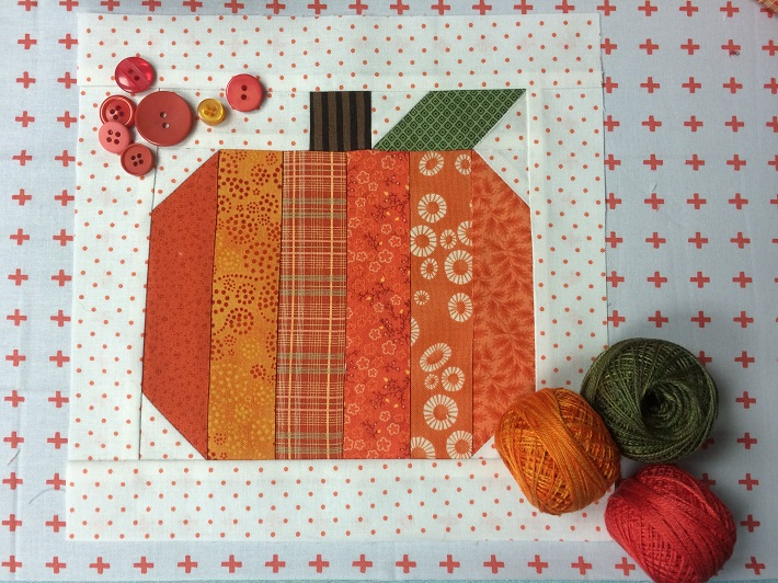 15 Fabulous Patterns for Fall - October-Scrappy-Pumpkin-Block - Let me share some really great patterns and inspiration with you so you can start creating! Check out these 15 fabulous patterns for fall! #simple #TableRunners #AutumnLeaves #JellyRolls #WallHangings #FallQuiltBlocks #Quilting #ColorCombos #Fabric #PaperPiecing #Fun #Easy #Quick #pattern