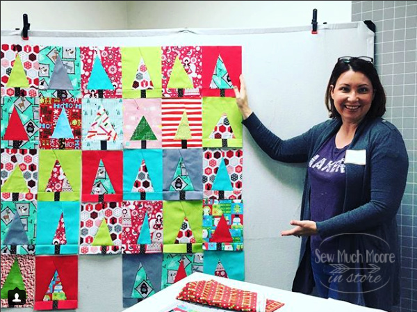 Modern Christmas Tree Quilt - Make this fun quilt and learn some tips to make your Guild Meetings fun again! #Christmas #ForBeginners #easy #quilt #Quilts #Quilting #ideas #modern#ToMake #Designs #Simple #Blocks #Tutorial #quilting #sewing #handmade #Project #Patchwork #Contemporary #WalkingFoot #DIY #Fabric #Bedding #Hip #Trendy #SewMuchMoore #SewMuchMooreInStore