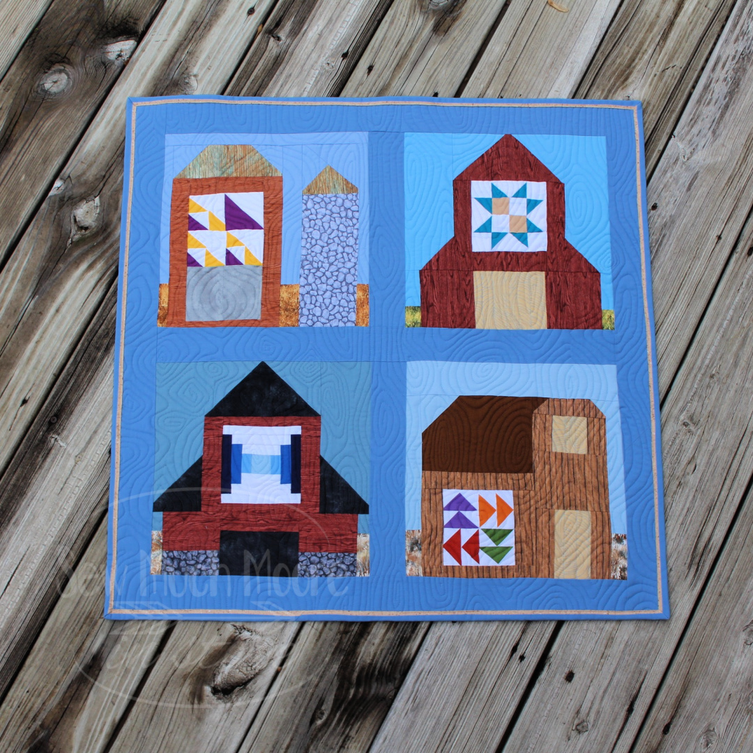 "Make your own Barn Mini Quilt with DIY block of the month kits! You can make one or make all twelve! #Easy #Patterns #Tutorial #Simple #OfTheMonth #12"" #Vintage #Modern #Star #ForBeginners #Scrappy #Quick #project #Fabric #Patchwork #DIY #Sampler #Ideas #Basic #HST #12Inch #StepByStep #Quilt #QuiltBlock #BOM #Quilting #Quilter #SewMuchMoore #SewMuchMooreInStore"