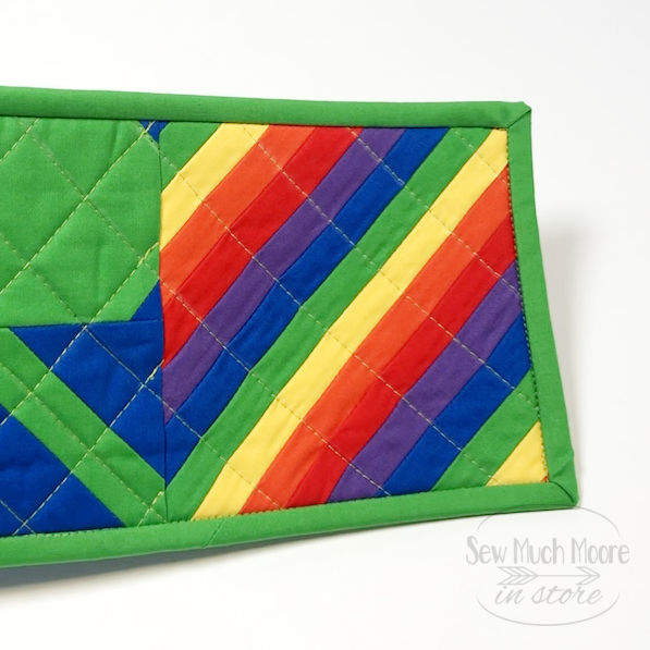Making a Lucky Clover Mug Rug is fun and easy! These mug rugs are the perfect project for St. Patrick's Day.  This is fun rainbow panel I made as an embellishment. #mugrugs #mugrug #coasters #handmade #sewing #quiltingismytherapy #SnackMat